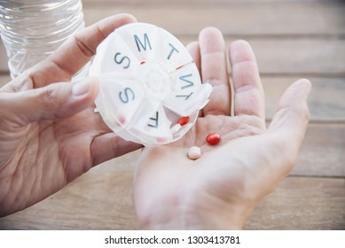 People prepare daily medicine tablet in pillbox - people healthcare with medicine pills concept