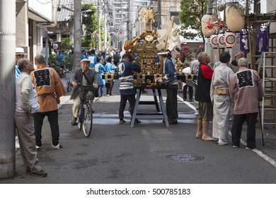 People prepare a portable shrine in a side street close to the senso-ji temple during the sanja matsuri 2016. Asakusa, Tokyo. Picture taken on 15 May 2016.