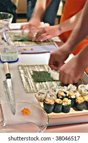 people  preparing sushi in the  kitchen
