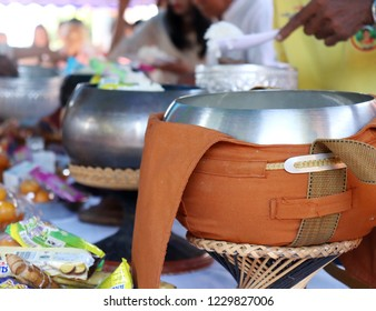 People are present food to a Buddhist priest,to place food or alms into a Buddhist alms-bowl,food offering to a Buddhist monk,merit by give rice,milk,snack,tradition of Buddhism in Thailand.