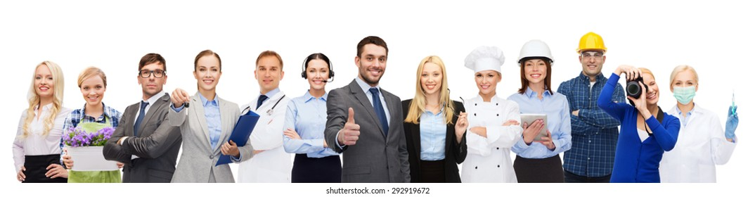 people, profession, qualification, employment and success concept - happy businessman over professional workers showing thumbs up