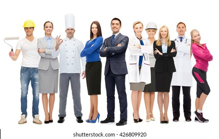 people, profession, qualification, employment and success concept - happy different businessman over group of professional workers