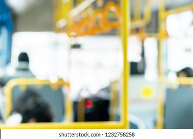 people in the public transport bus, blurred interior background