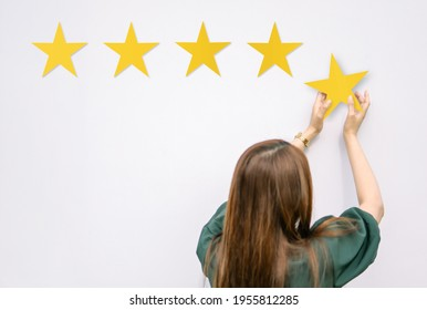 people puts star rating. concept of reviews five stars. and Testimonials, rating, feedback, survey and quality and review.