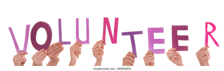 People putting hands in air together with word made of paper letters on white background. Volunteering concept