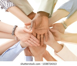 People putting hands together, closeup. Help concept