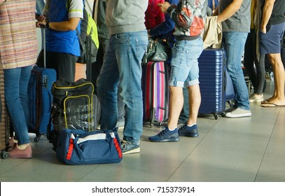 people in que waiting for check in at airport.