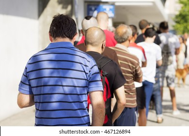 people  queue  in  line up ,  draggle