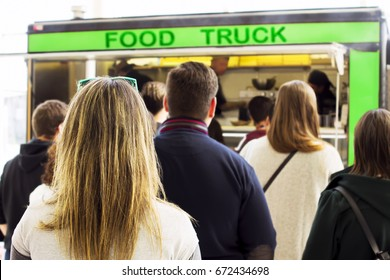 people  queue  in  line up ,  draggle , in truck food