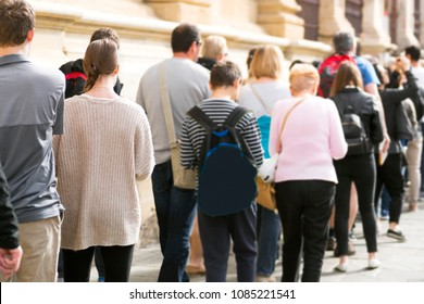 people  queue  in line, selective focus