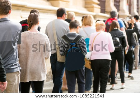 people  queue  in line, selective focus