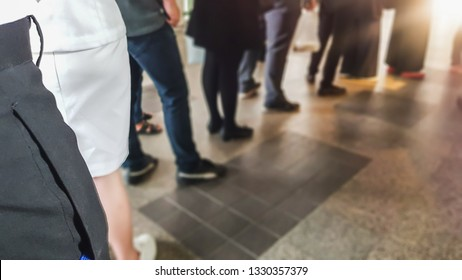 People in queue waiting for buying coffee in morning.  Man and woman orderly in line with defocus