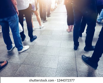 People in queue waiting for something. Back of man and woman Orderly in line with defocus