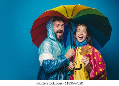 People in rain. The autumn mood and the weather are warm and sunny and rain is possible. Rain and umbrella november concept. Happy family in Autumn