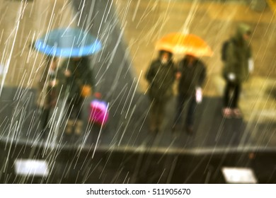 people in rainy day in crosswalk of city street