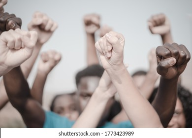 People raised fist air fighting for their rights. Labor movement, election movement, no racism and union concept. Image