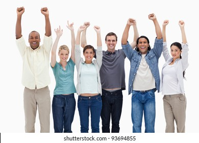 People raising their arms against white background
