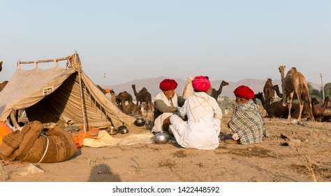 People with red turban chatting during the camel fair at Pushkar : Pushkar, Rajasthan/India - Oct 2017
