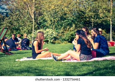 People relax in Holland Park, London, on the hottest spring day. Holland Park is the largest park in Kensington and Chelsea. London - UK, April 9 2017