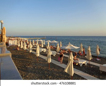People relax on the beach on the Black Sea resort of Sochi, Russia, August 8, 2016