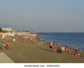 People relax on the beach, the sea coast Sochi, Russia, August 8, 2016