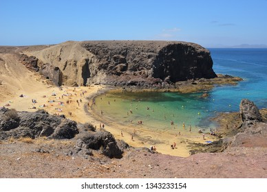 People relax on the famous Papagayo Beach on the Lanzarote Island in the Canary Islands, Spain