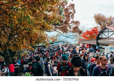 People relaxing after trekking to the top of Mount Takao (Takao San), Tokyo, Japan -- while having Maple Leaf Festival in November 2016