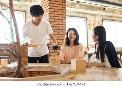 People relaxing at cafes and cafe staff