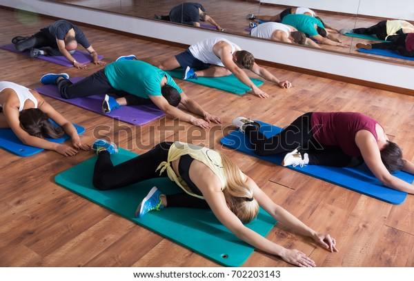 People relaxing and enjoying yoga elements