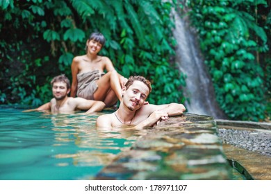 People relaxing in the hot spring