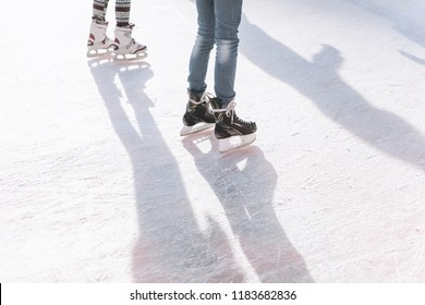 People ride on the skating rink on the ice rink during the Christmas holidays. Sports and fun pastime.