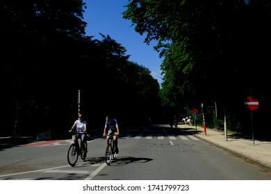 People ride their bike during a sunny day in The Bois de la Cambre which is an urban public park o in Brussels, Belgium on May 17, 2020