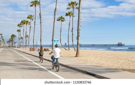 People riding Bikes at beach