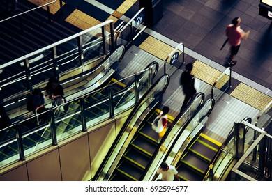 People riding escalators