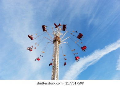 People riding high in the air on a carnival festival