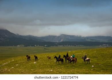 People riding horses at Jezera upland , Durmitor National Park, Montenegro, 28.06.2018