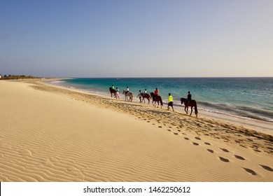 People riding horses on the beach at sunset time, Sal island, Cape Verde