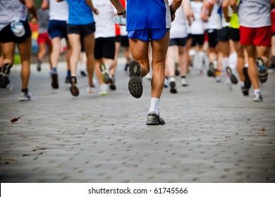 People running in city marathon
