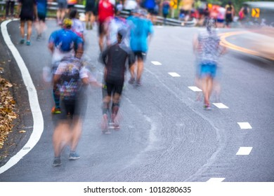 People running in a city marathon on street