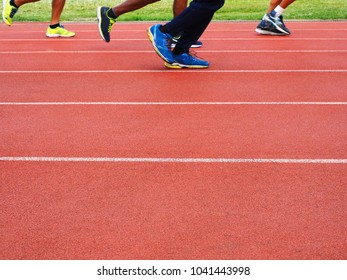 People running or jogging at running track