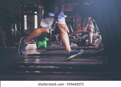 People running in machine treadmill at fitness gym