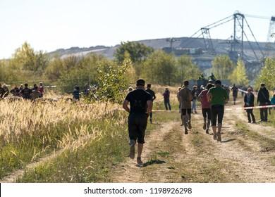 People running a marathon in nature