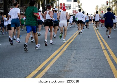 People running on the street in the urban marathon event.