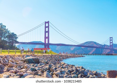 People running on sunny weekend by Golden Gate Bridge in San Francisco, California