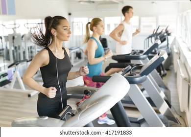 People running on treadmill at gym