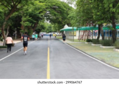 people running in the park process in blurred