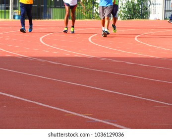 people running at stadium. running track. Exercise to healthy