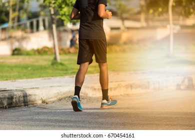 people running and walking in public park in evening day for health
