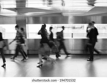 People rushing in the lobby. Motion blur.
