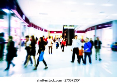 People rushing in the lobby. motion blur